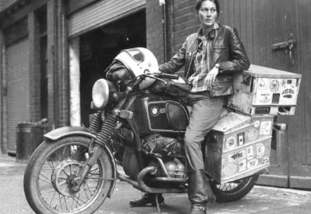 <h3>An adventure pioneer</h3>  How did Elspeth Beard became the first Englishwoman to ride a motorcycle around the world? While she is studying archaeology in England, Elspeth starts to feel like discovering other places. With her BMW R 60/6, which she works on alone in her garage, she travels through Ireland and Scotland, then mainly Europe. In the first two years of her bike ownership, she will rack up over 10,000 miles. This spirit of discovery will never leave her from then on, instead it starts to grow...and it grows big! It's decided: she will go travel the world after her third year of university. To get the necessary funds to carry out her project, she works in the bar of her university in the evening, after classes. After having saved enough money, she gears up and takes off to the Big Apple.