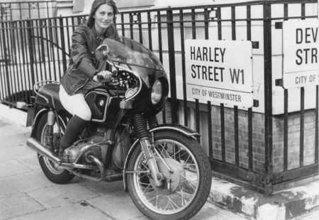 """<h3>From America to Oceania</h3>  Driving her faithful motorcycle, she discovers Canada before continuing her <a href=""""http://www.vintagerides.travel/"""">motorcycle tour</a> through the United States to reach Mexico. From there, she heads back up North to Los Angeles from where she embarks on a ferry across the Pacific to get to Sydney. Her bike joins few days later. She spends seven months in Sydney. Along with the development of an architectural project as part of her studies, she lives in a garage and blossoms discovering the Australian roads. This time allows her to replenish her diminished funds. After a two weeks stay at the hospital due to an accident, she doesn't give up and continues her trip in Australia. She still has the Bell 'bone dome' helmet that she's convinced saved her life (and which she carried on wearing for the rest of the trip!). Her thirst for discovery strongly increases."""