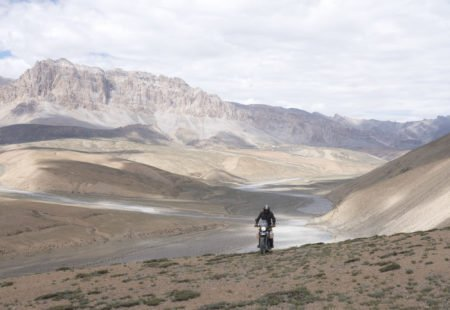 """<h2>The most beautiful leg of your <a href=""""https://www.vintagerides.travel/motorcycle-tour/india-himalaya/"""">motorcycle tours in Ladakh</a>?</h2> I love the Nubra Valley and its special atmosphere, particularly Sumur, an idyllic little village. I never get tired of walking along the canals, taking in the peculiar vegetation and snow-peaked mountains in the background. And, of course, crossing Wari Pass, not Khardung, to get there, which is the more scenic and less-frequented road."""