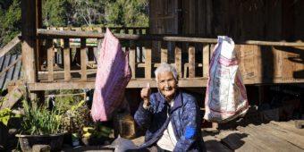 woman sitting down village