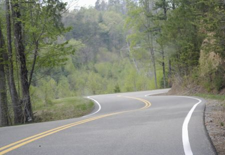 <h2> 5) Deal's Gap in Tennessee </h2> Imagine riding a motorcycle along a dragon's tail. You're turning left, your turning right, you're leaning left, you're leaning right. That's what Deal's Gap feels like, hence the nickname, Tail of the Dragon. Close to the border of The Great Smoky Mountains National Park, The Dragon is extremely challenging and full of curves. 318 curves along 11 miles to be exact. You're sideways pretty much the whole time! Ride along vibrant forest and green mountains. Challenging for beginners and experts, Deal's Gap will keep you on your toes the whole time.