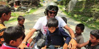 rider with children nepal