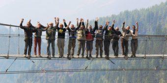 group tourists bridge nepal