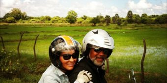 sri lanka motorcycle couple paddy field